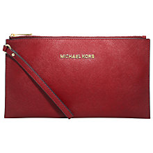 Buy MICHAEL Michael Kors Jet Set Travel Zip Leather Clutch Bag, Red Online at johnlewis.com
