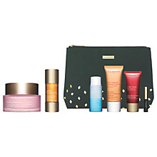 Buy Clarins Golden Glow Booster and Multi-Active Day Cream with Gift Online at johnlewis.com