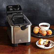 Buy Chocolate sauce to serve over doughnuts, icecream or profiteroles Online at johnlewis.com