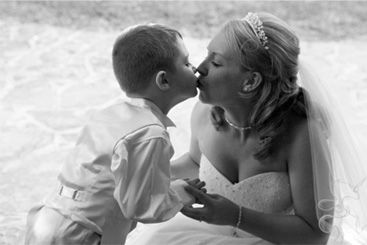 Wedding Image of Bride Kissing Page Boy