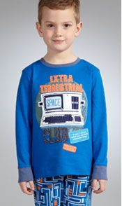 Young boy wearing robot pyjamas