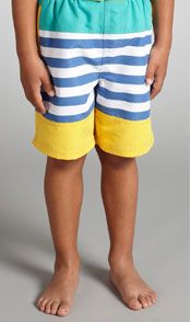 Young boy wear striped swimming shorts