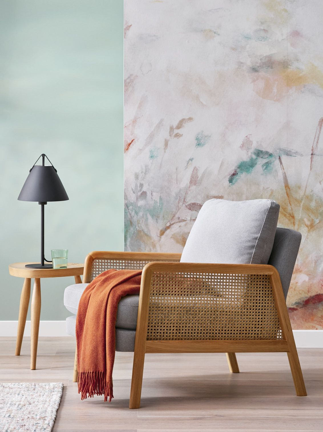 Contrast light wooden furniture with statement home accessories