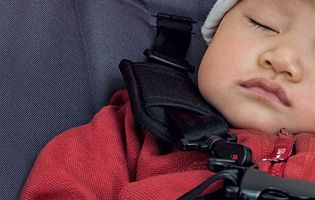 Small child sleeping in car seat