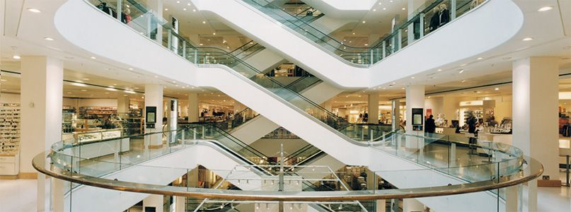 Peter Jones, Sloane Square, London - Interior view featuring escalators