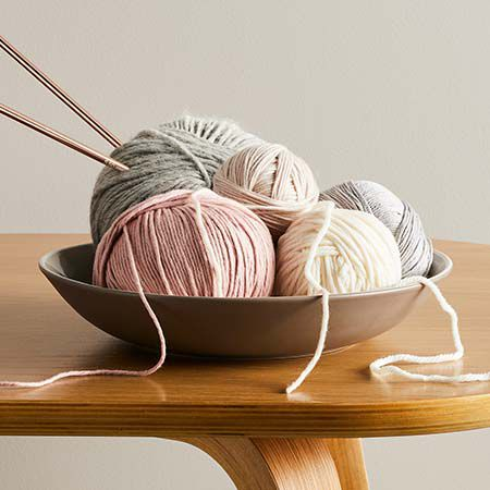 Balls of wool with knitting needles