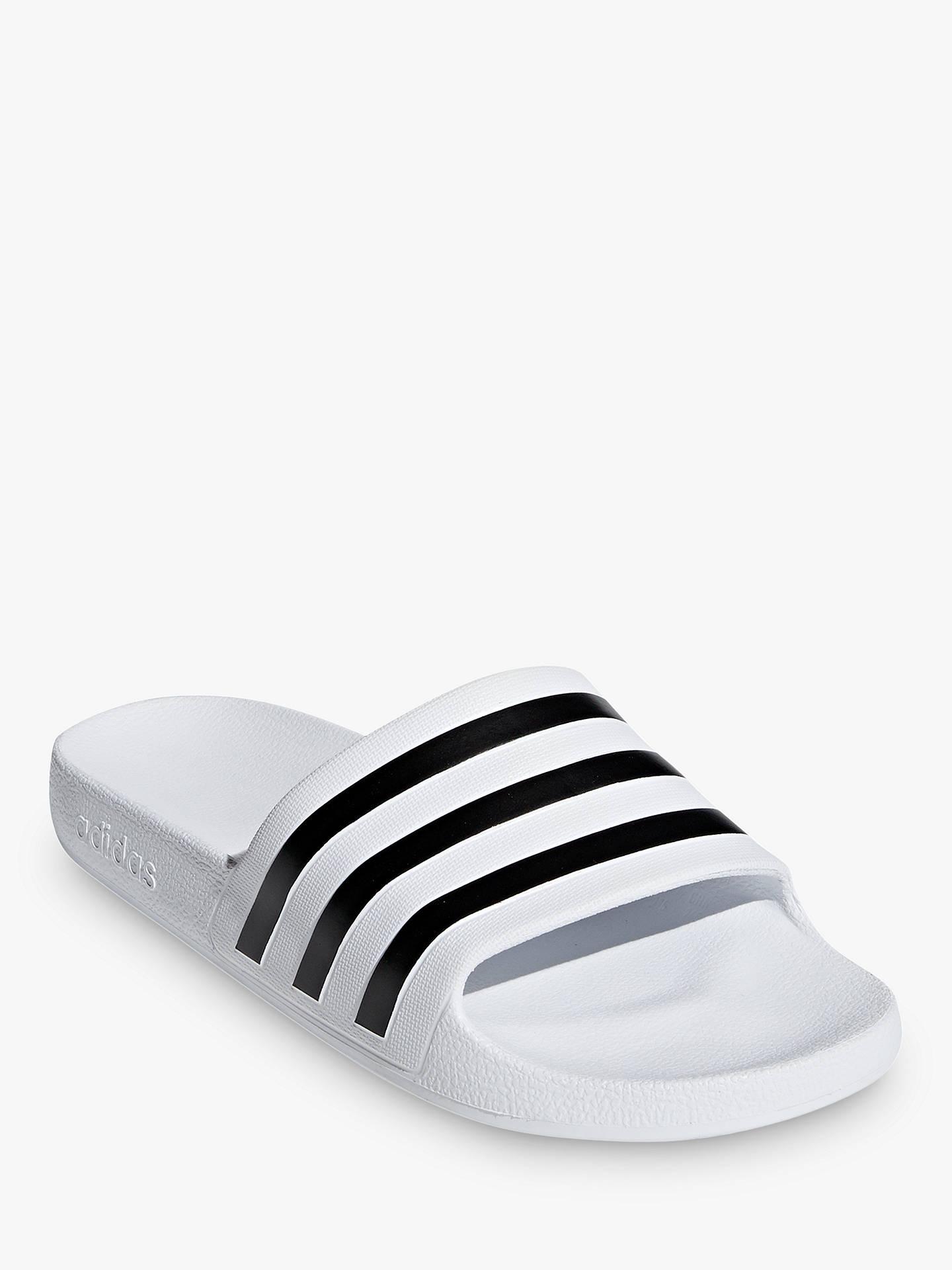 hot sale online bb2f6 22eca ... Buy adidas Adilette Aqua Women s Slides Slippers, White Black, 5 Online  at johnlewis ...