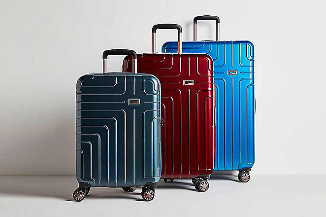 Three suitcases side by side