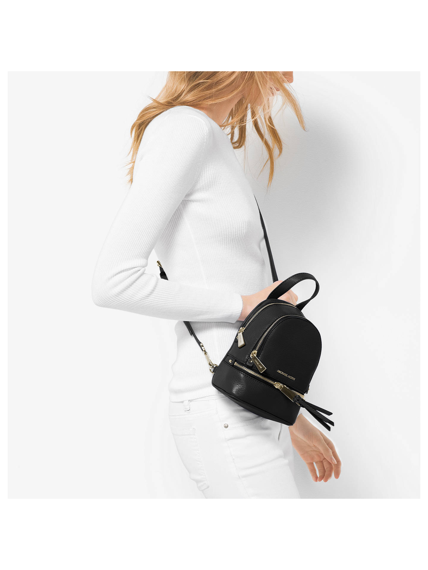 00c9015f9514 MICHAEL Michael Kors Rhea Extra Small Leather Backpack at John Lewis ...