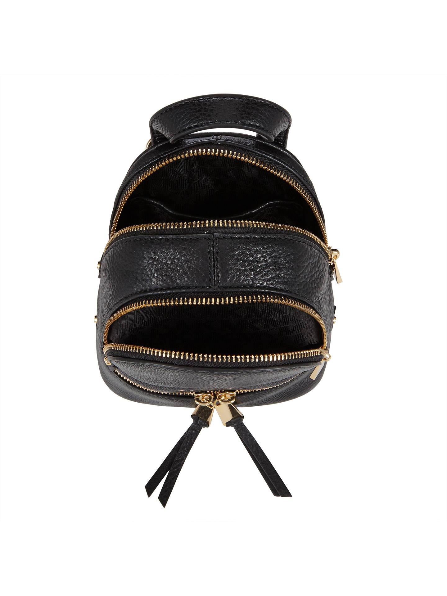 5d913de8cd82 ... store buymichael michael kors rhea extra small leather backpack pebbled  black online at johnlewis eda7b fdb40