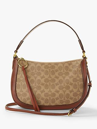ac4a93d105 Coach Sutton Signature Cross Body Bag