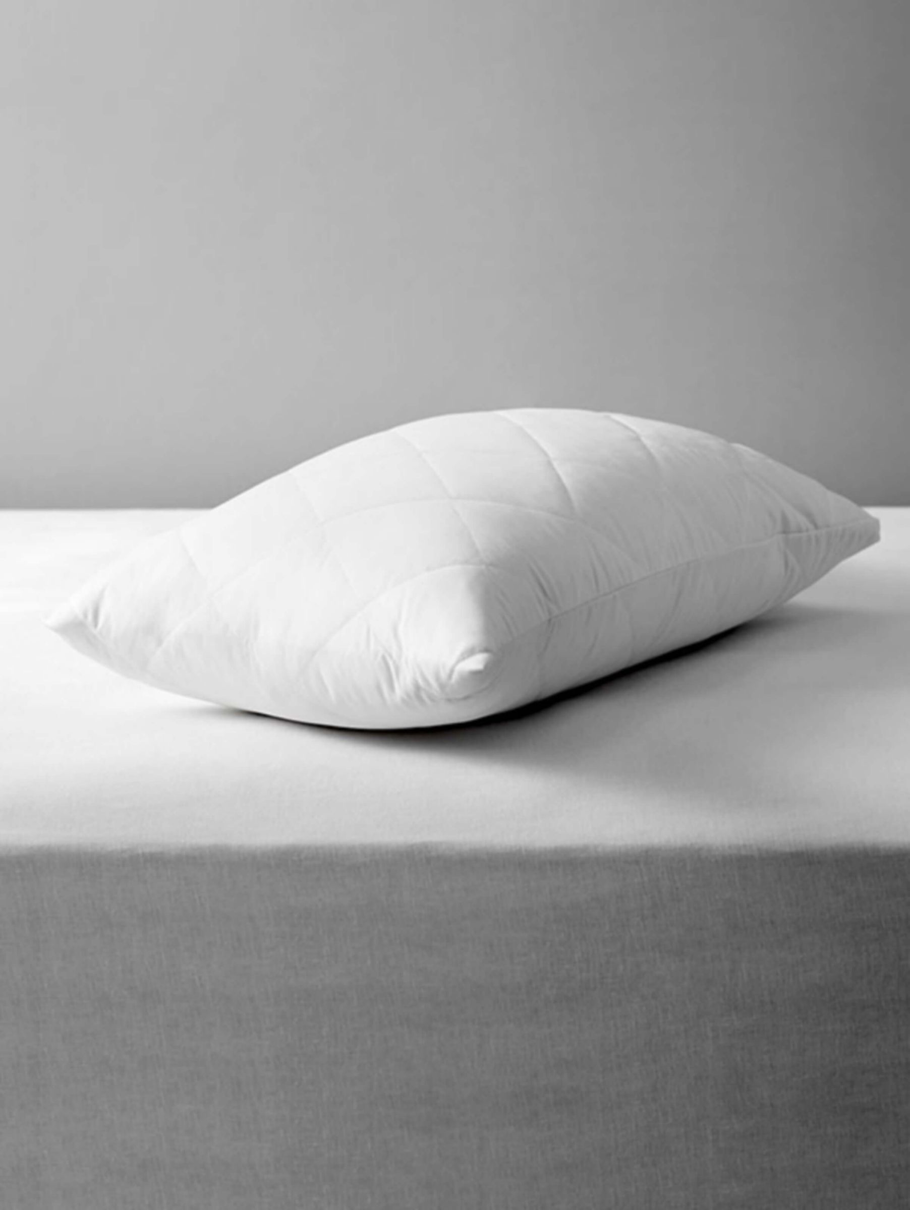 open cotton protectors etc stacked down bedding protector pillow essential white