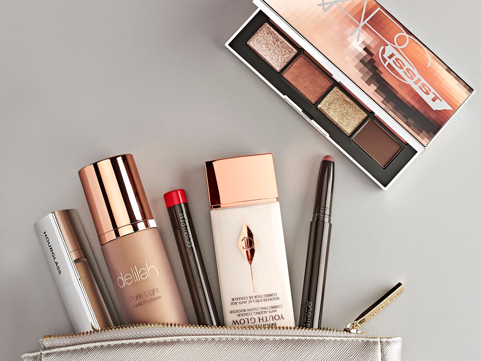 A collection of Spring beauty products from brands including Charlotte Tilbury, NARS and Laura Mercier, from John Lewis