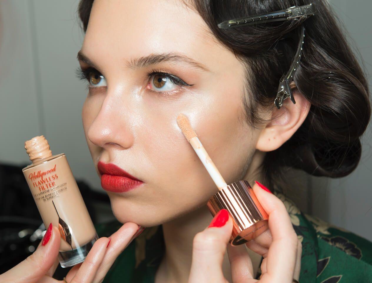 Charlotte Tilbury applying model's makeup backstage at Alice Temperley LFW