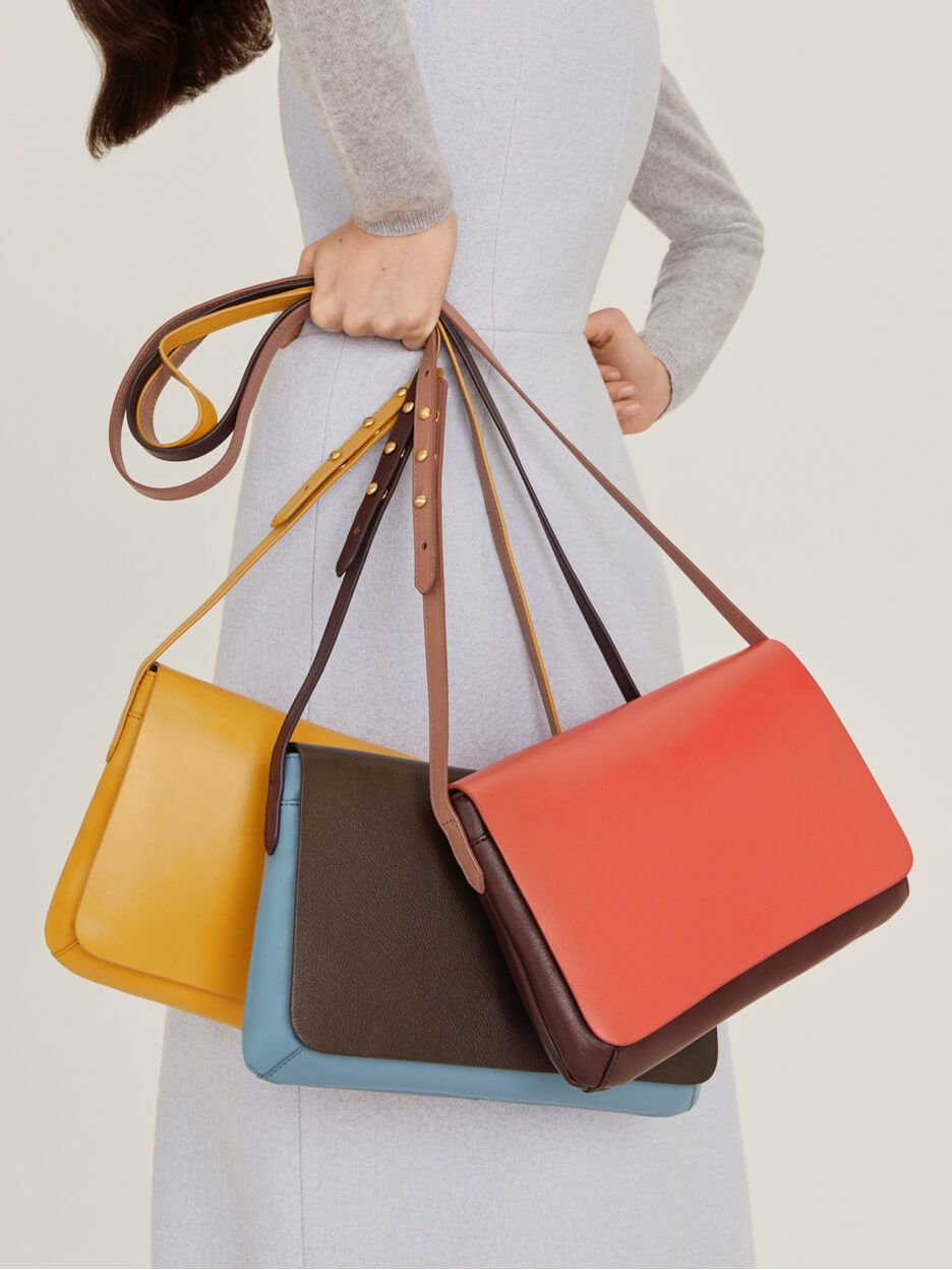 Model holding coloured bags