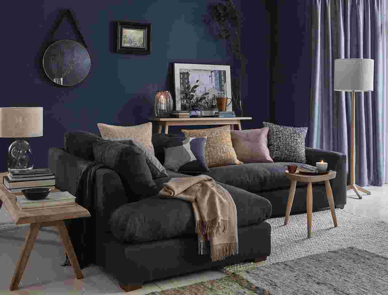 Dark grey sofa in a blue living room