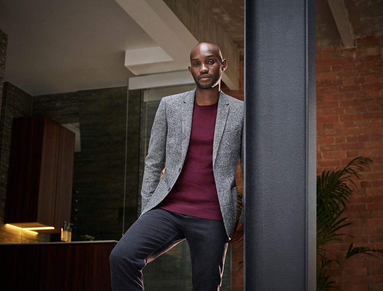 Model in grey slim fit blazer