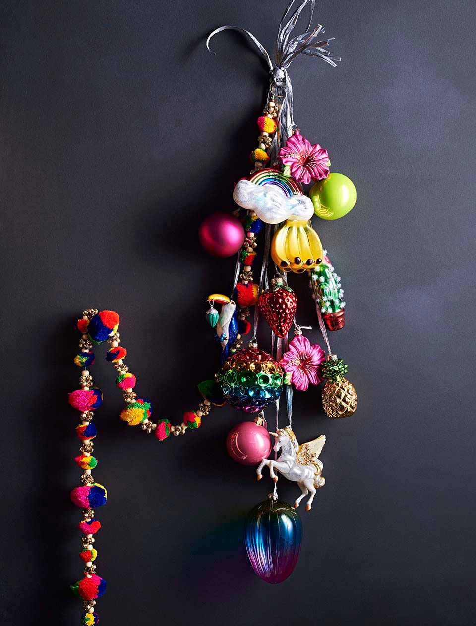 Baubles hanging from ribbon on the wall