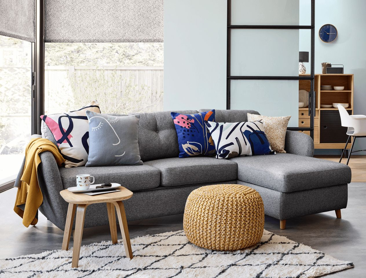 Light grey sofa with patterned cushions