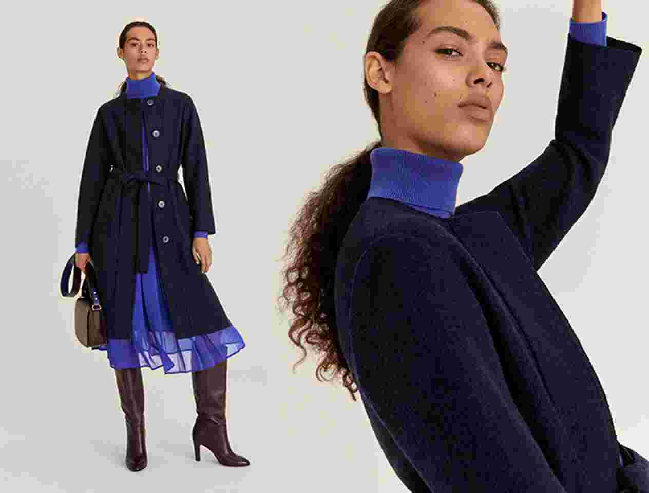 Model in a navy coat and blue dress
