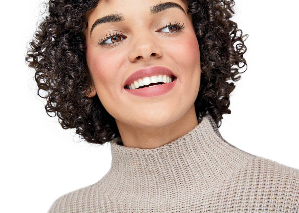 Model wearing nude matte lipstick