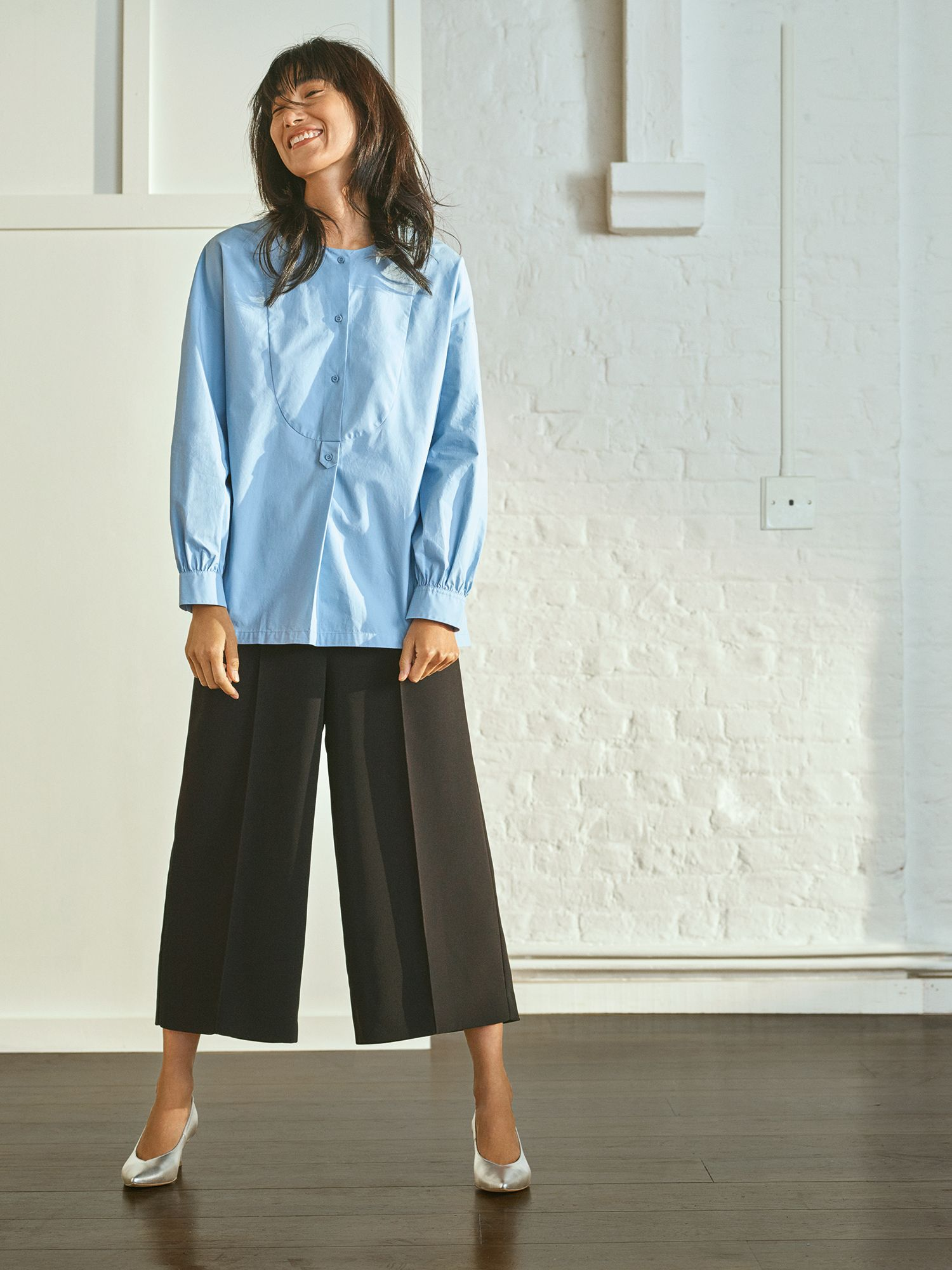 A fashion model wearing tailored cropped trousers by John Lewis