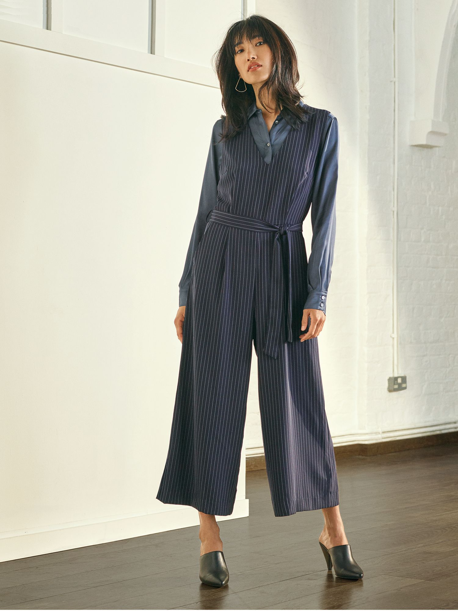 A model wearing a jumpsuit by John Lewis