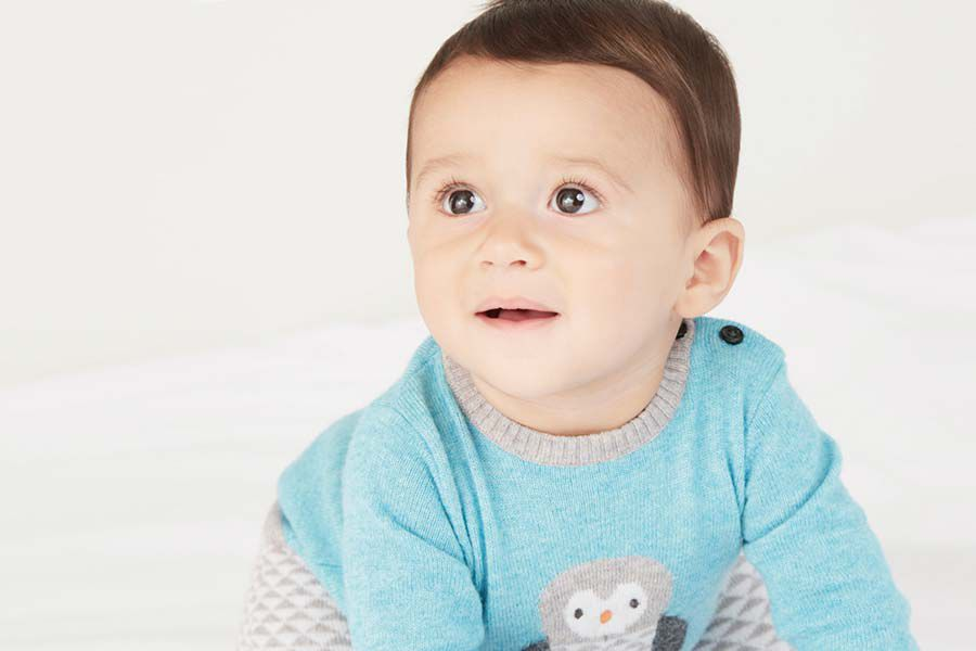 Baby wearing knitted jumper
