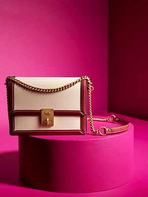 Top gifts for her - Coach handbag on pink background