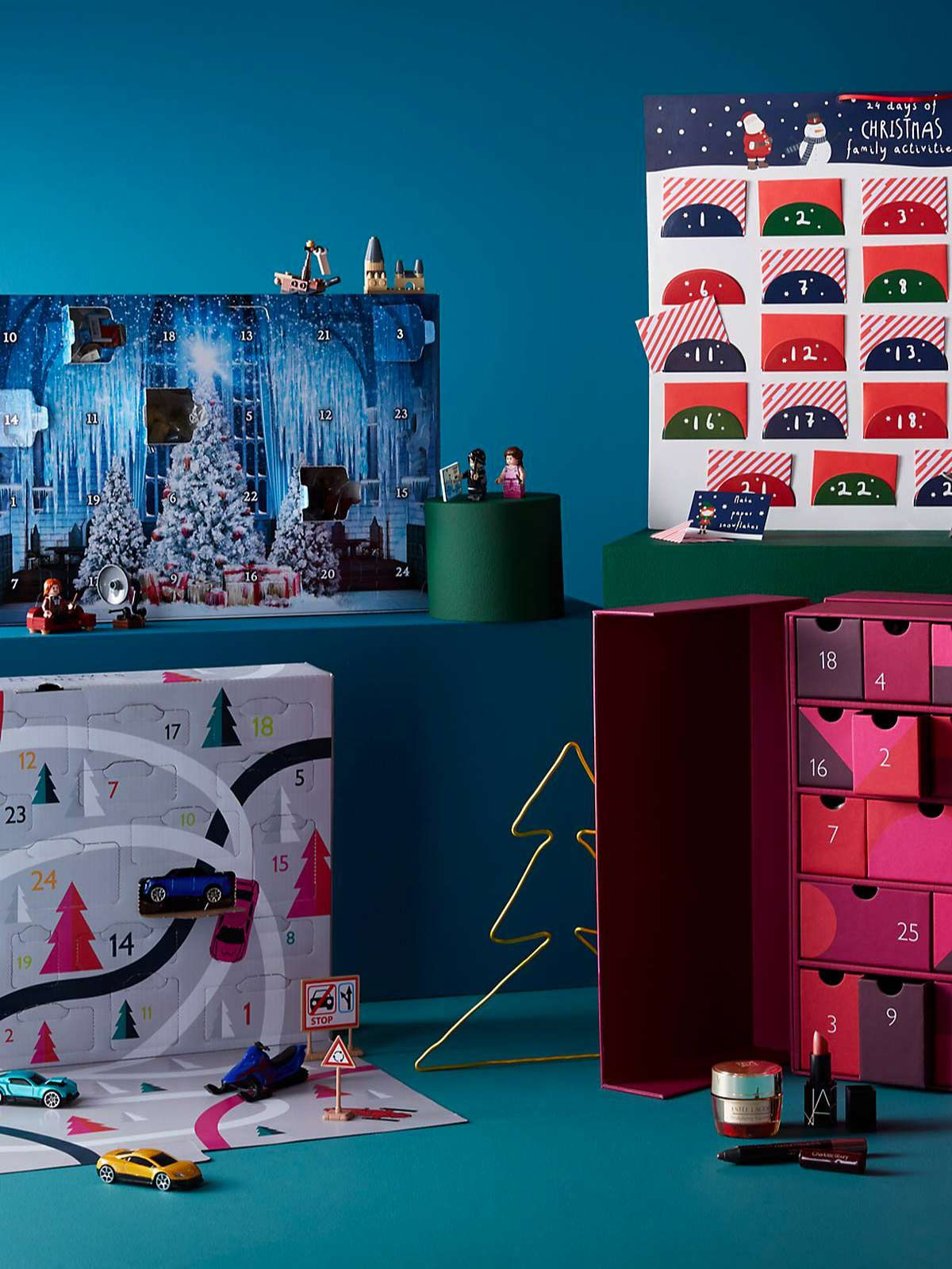 Assortment of advent calendars on turquoise background