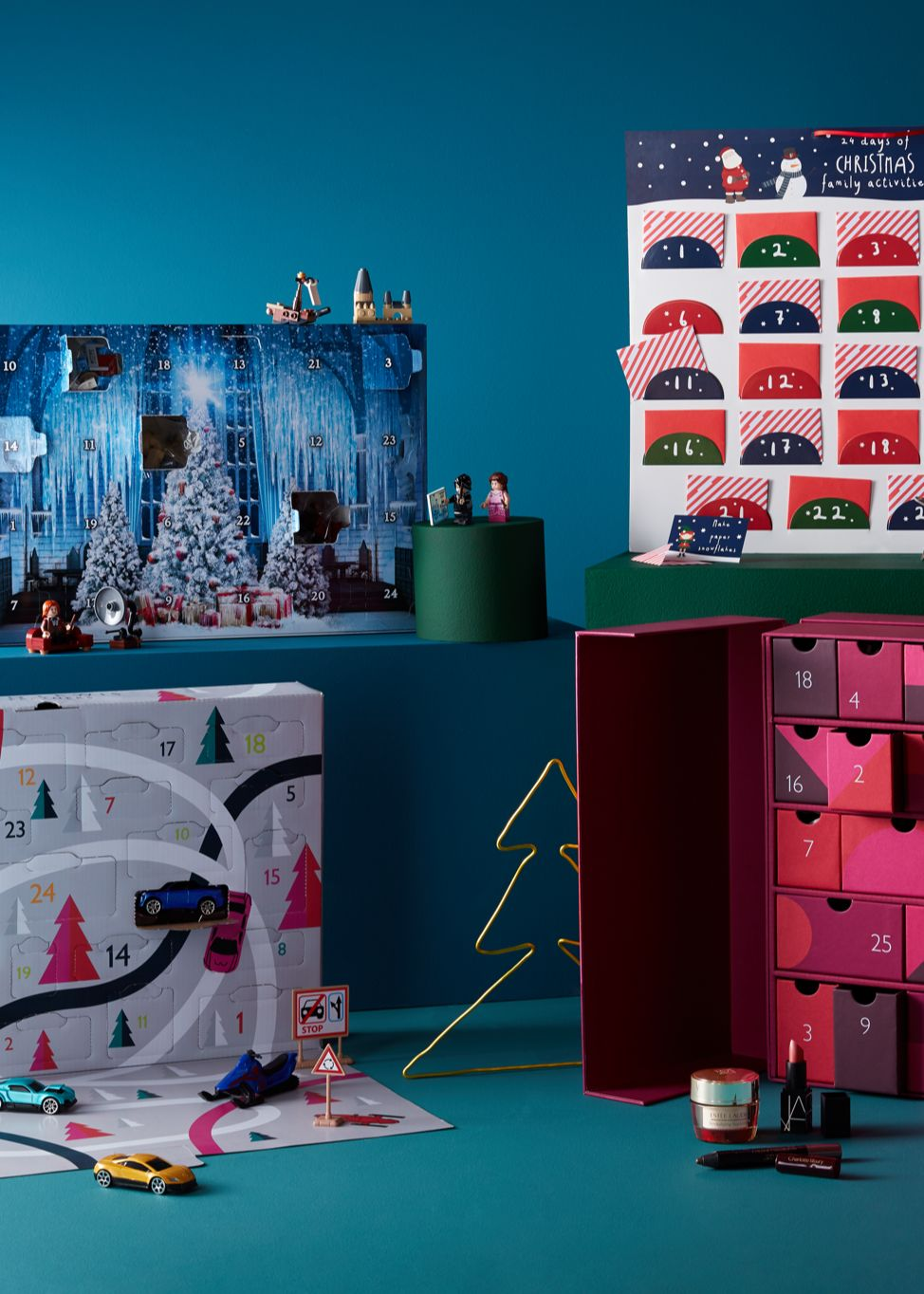 an selection of advents calendars on a blue backdrop