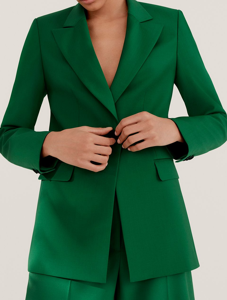 Woman in a green suit