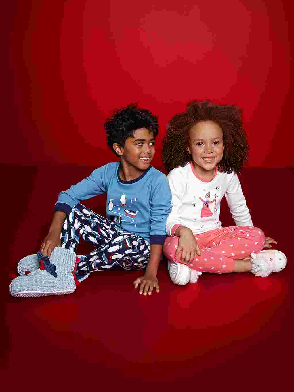 Boy and girl in fun nightwear and slippers
