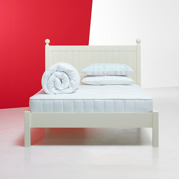 Bed with mattress, pillow and duvet