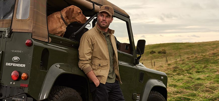 Man & his dog with Range Rover in the Country