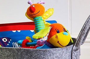 Colourfull toys peeking out of a grey felt storage container