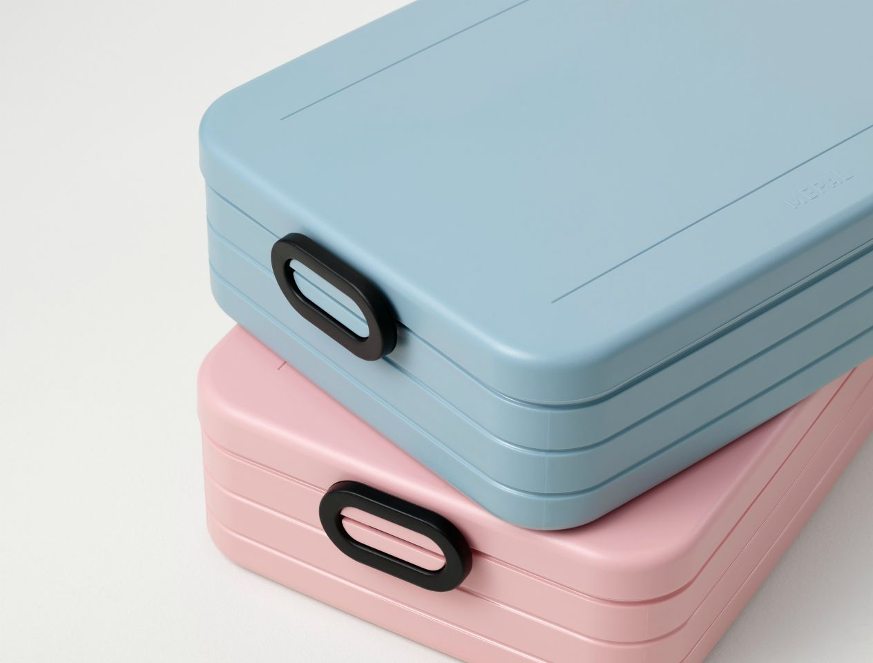 stack of lunchboxes