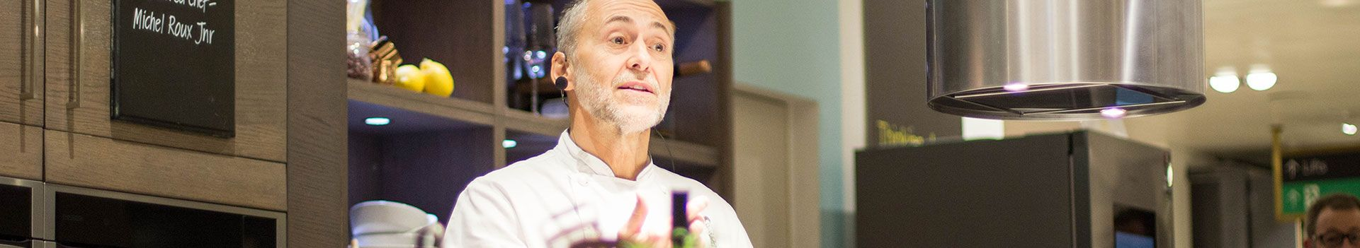 Michel Roux behind counter