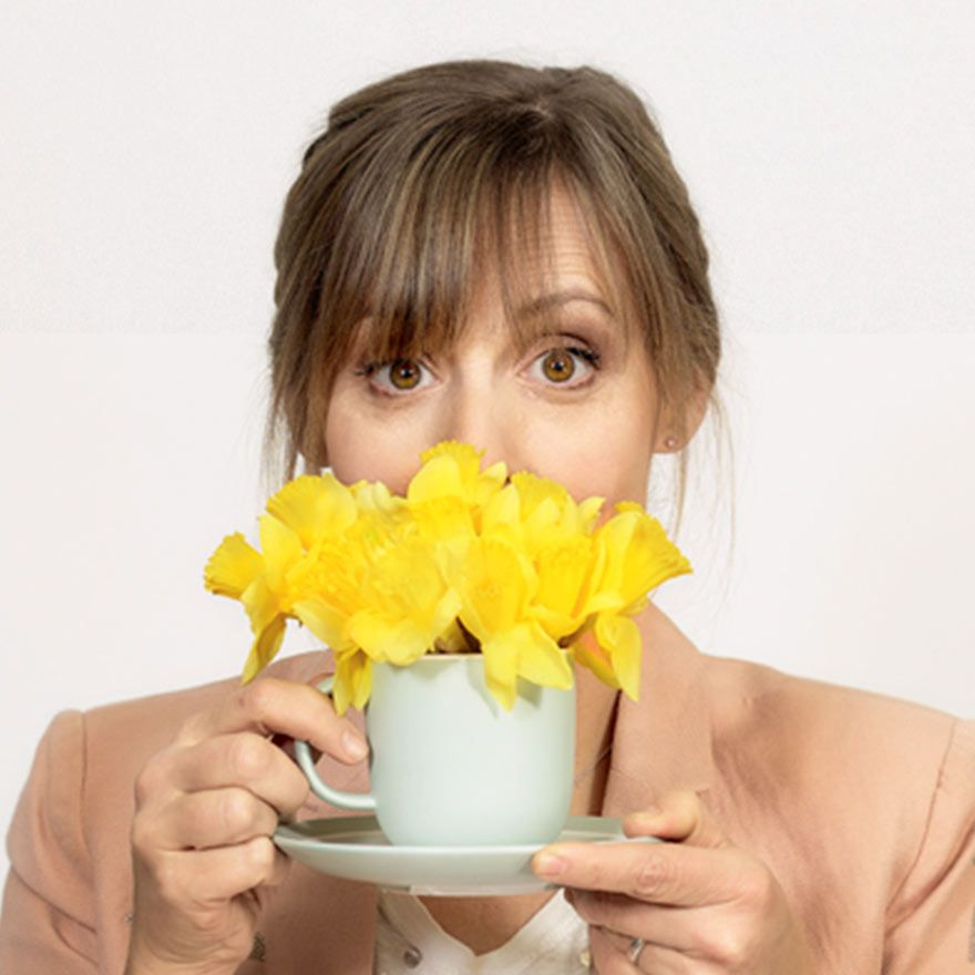 Mel with daffodils and a Teapot