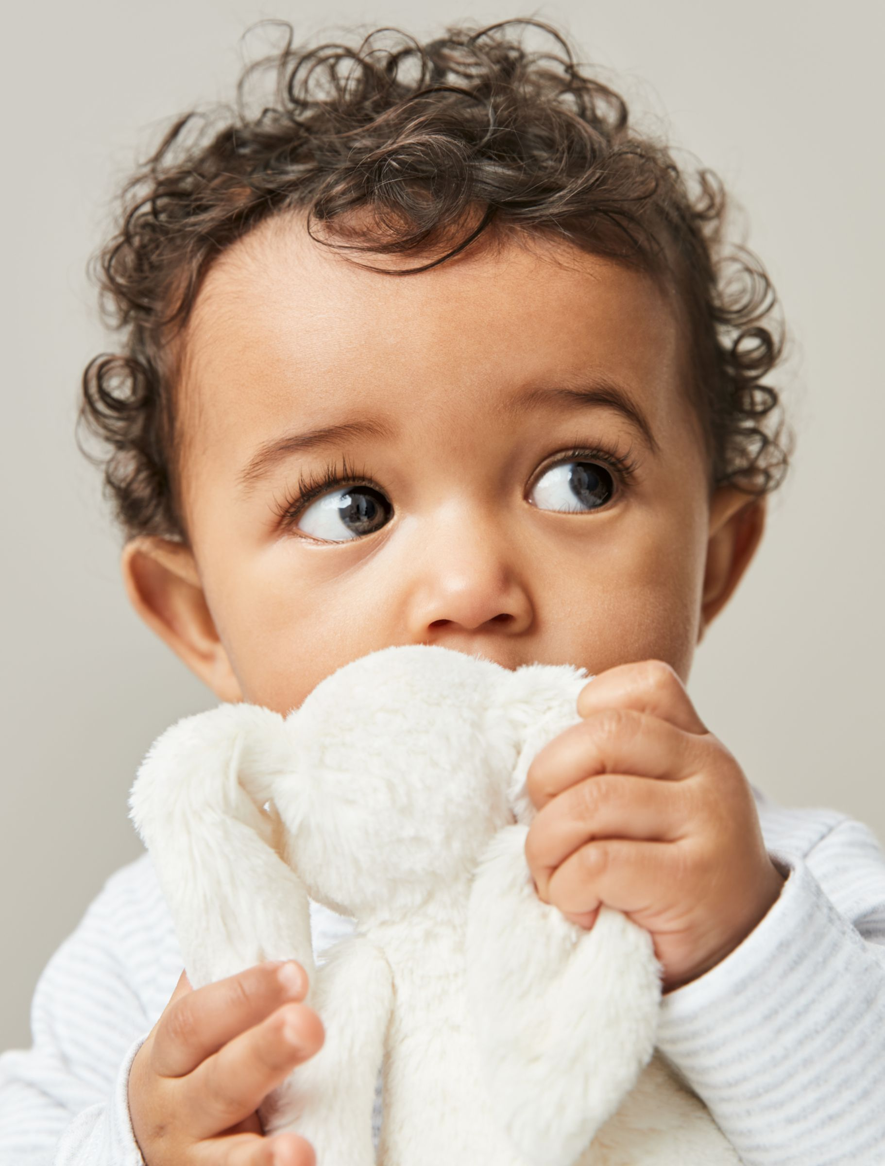 Cute baby with soft toy