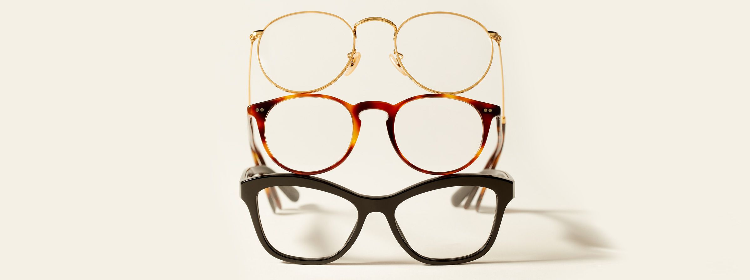 an image of three reading glasses stacked ontop of eachother