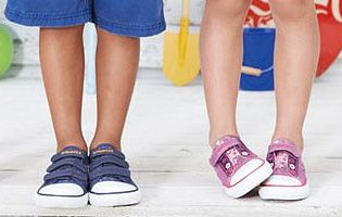 Children standing in plimsoles