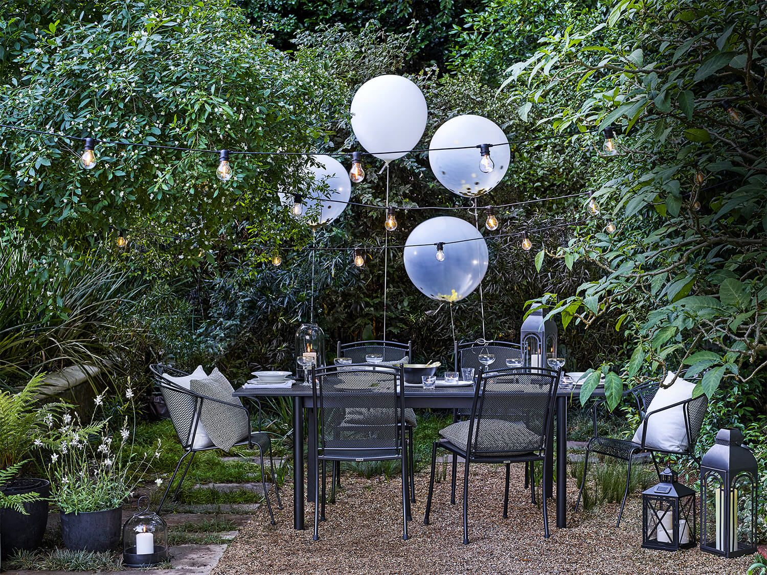 Outdoor table and chairs with giant balloons