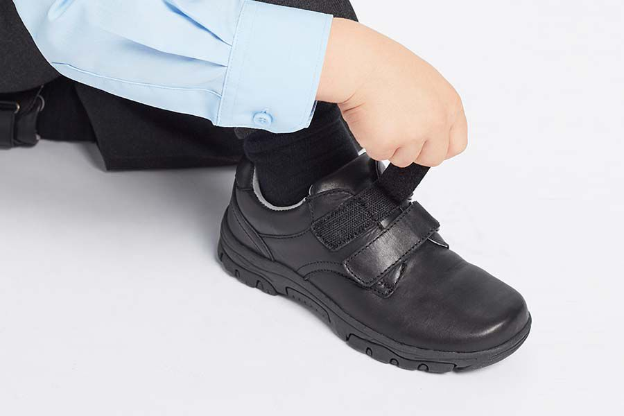 Child putting on shoe