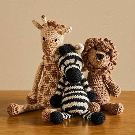 Knitted animals sitting on table