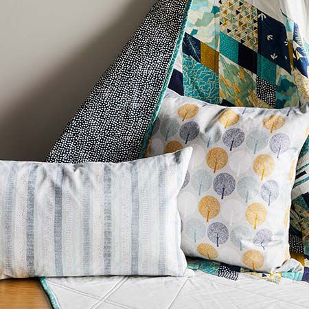 Patterned cushions with fabric behind