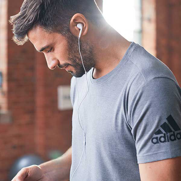 Man in gym wearing headphones