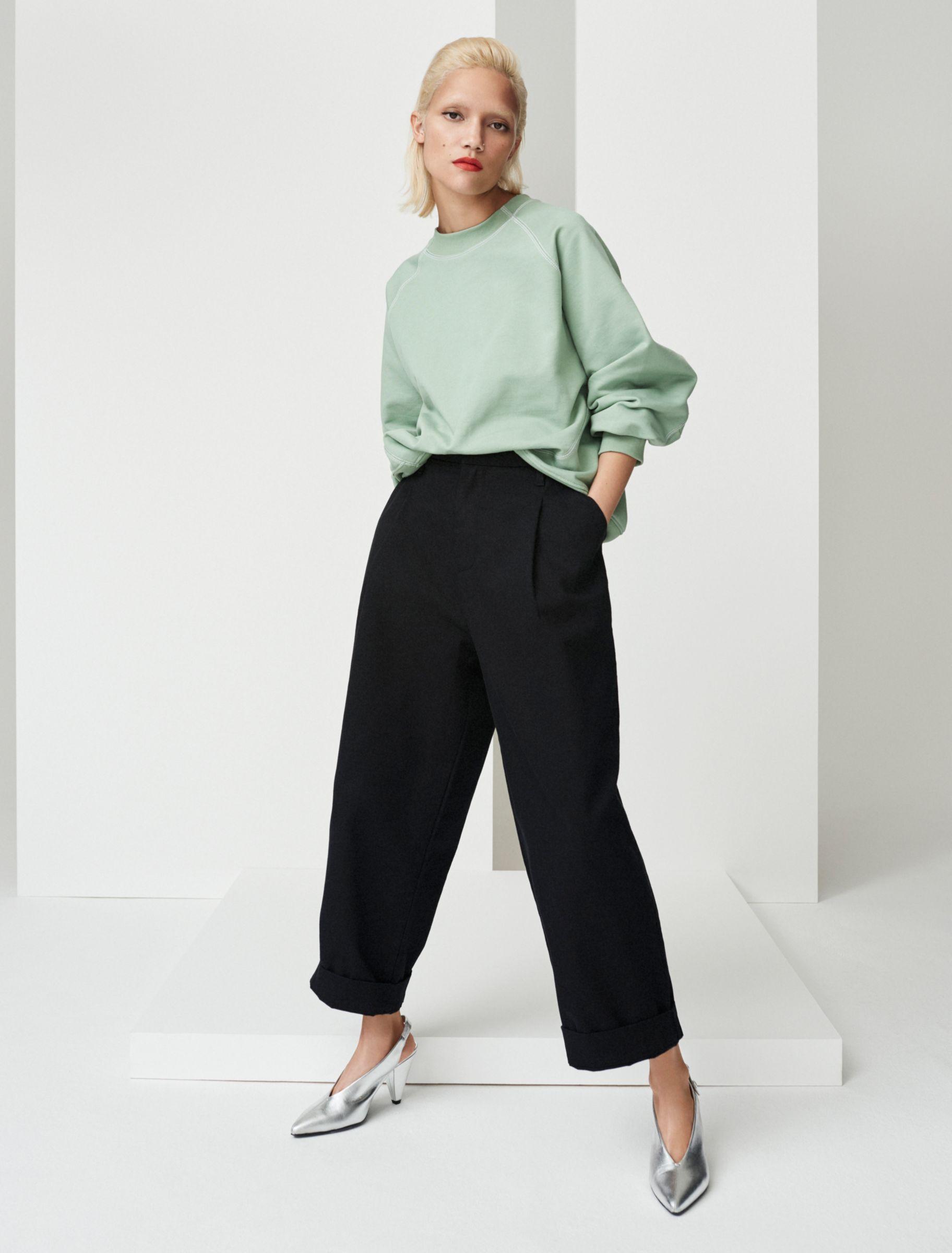 Woman in green jumper