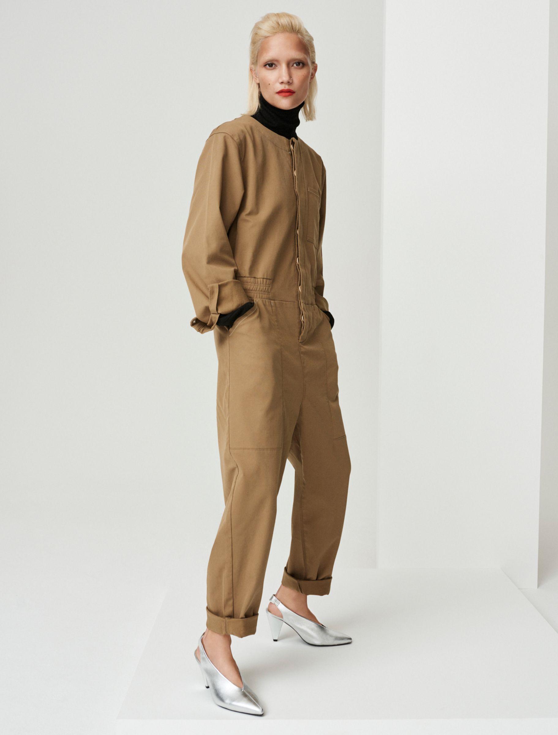 Woman in khaki jumpsuit