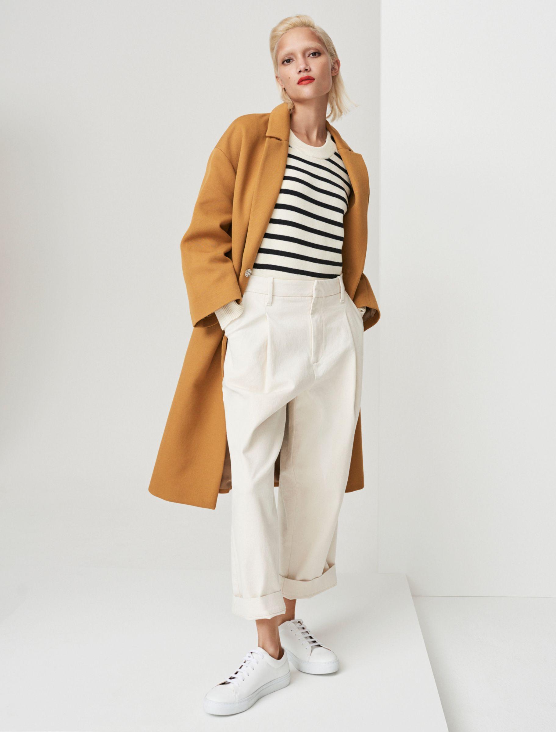 Woman in tan coat